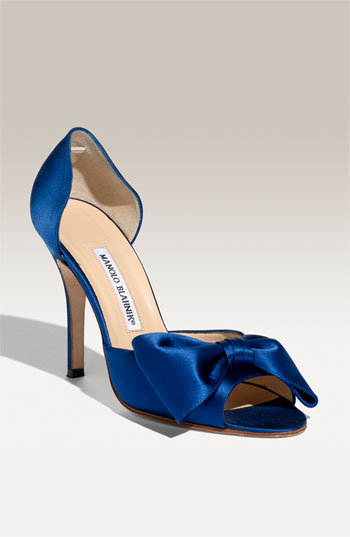 How about shoes Blue wedding shoes are a fun way to bring a pop of color to